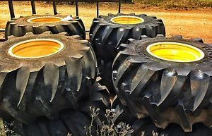 Brand New Firestone 28LX26 Log Skidder Tires 16 Ply Mounted on John Deere Wheels