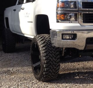 "KMC Rockstar 2 s Wheels 22x12 with 35"" Mud Tires"